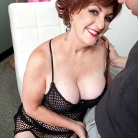 Hot older redhead sports red lips while hooking up with her younger paramour
