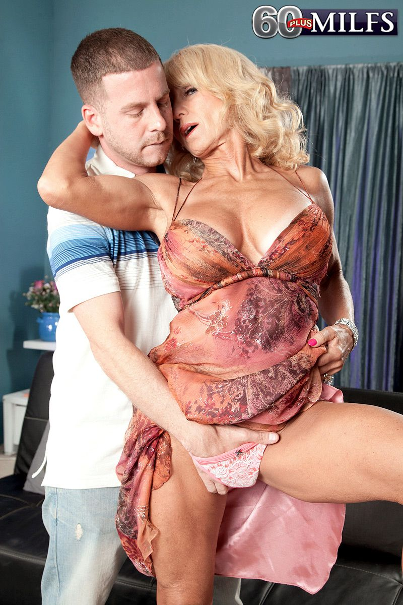 Over 60 blonde babe has her nice breasts freed from a dress by her toy boy