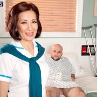 Mature Asian pornstar giving large cock CFNM handjob in hospital bed