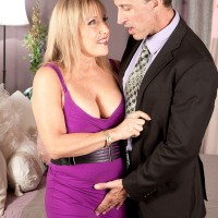 60 plus blonde shows her bare legs while during a seduction scene