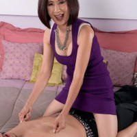 Asian granny seduces the neighbor's grandson while alone with him in the bedroom