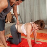 Over 60 redhead in yoga pants having large all natural tits exposed by instructor