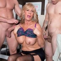 Over 60 blonde lady tugs on the hard dicks of a couple of younger guys at once