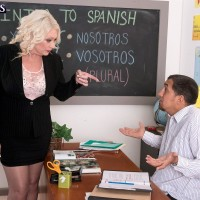 Stocking and skirt adorned 60 plus MILF teacher unleashing massive hooters