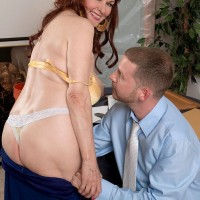 Old redheaded lady exposes her saggy boobs while seducing a younger man