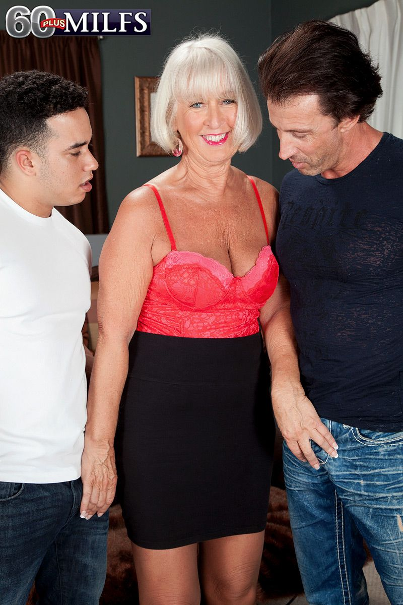 Sexy over 60 lady seduces a couple of younger men in a black skirt and hose