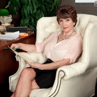 Older lady with great legs seduces a younger gentleman in sheer pantyhose