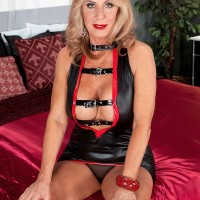 Hot blonde granny seduces her man friend in a revealing latex dress and red heels