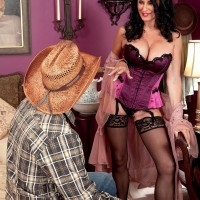 Sexy over 60 woman seduces a younger man in hot lingerie and hosiery + garters