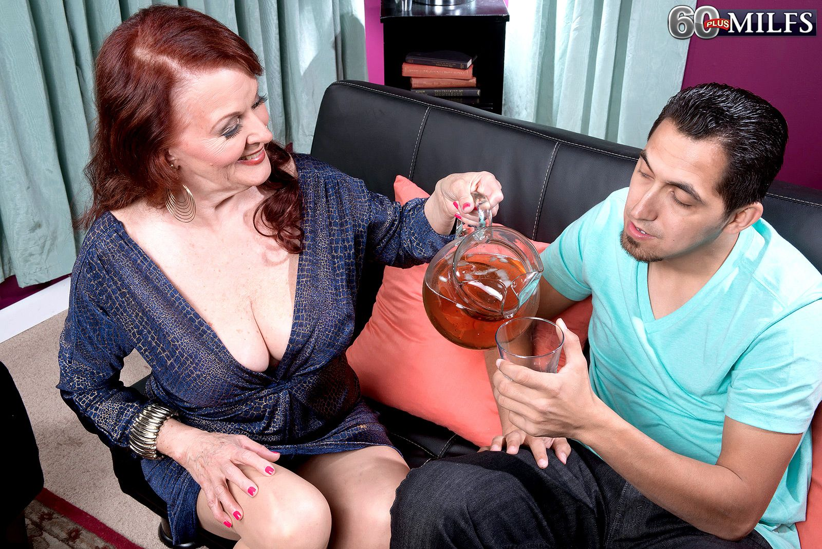 Redheaded granny serves up refreshments while seducing a younger man