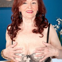 Stocking clad granny with red hair giving big cock oral sex on knees