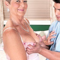 Short haired granny loosing large mature tits before giving blowjob in pantyhose