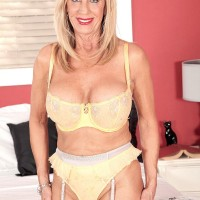 Over 60 blonde uncups her large tits after giving a younger man a back rub