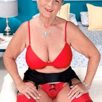 Mature lady with short hair has her nipples licked by her much younger lover