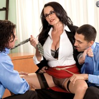 Mature woman Rita Daniels seduces a couple of men wearing a short red skirt