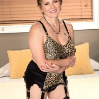 Older redhead meets her younger lover in pretties and nylons + garters