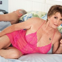 Over 60 MILF with short hair is freed from pink lingerie by her toy boy