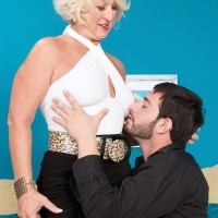 Over 60 platinum blonde is stripped down to her pantyhose by a young man