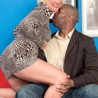 Platinum blonde granny takes a younger man's black cock in her wanton mouth