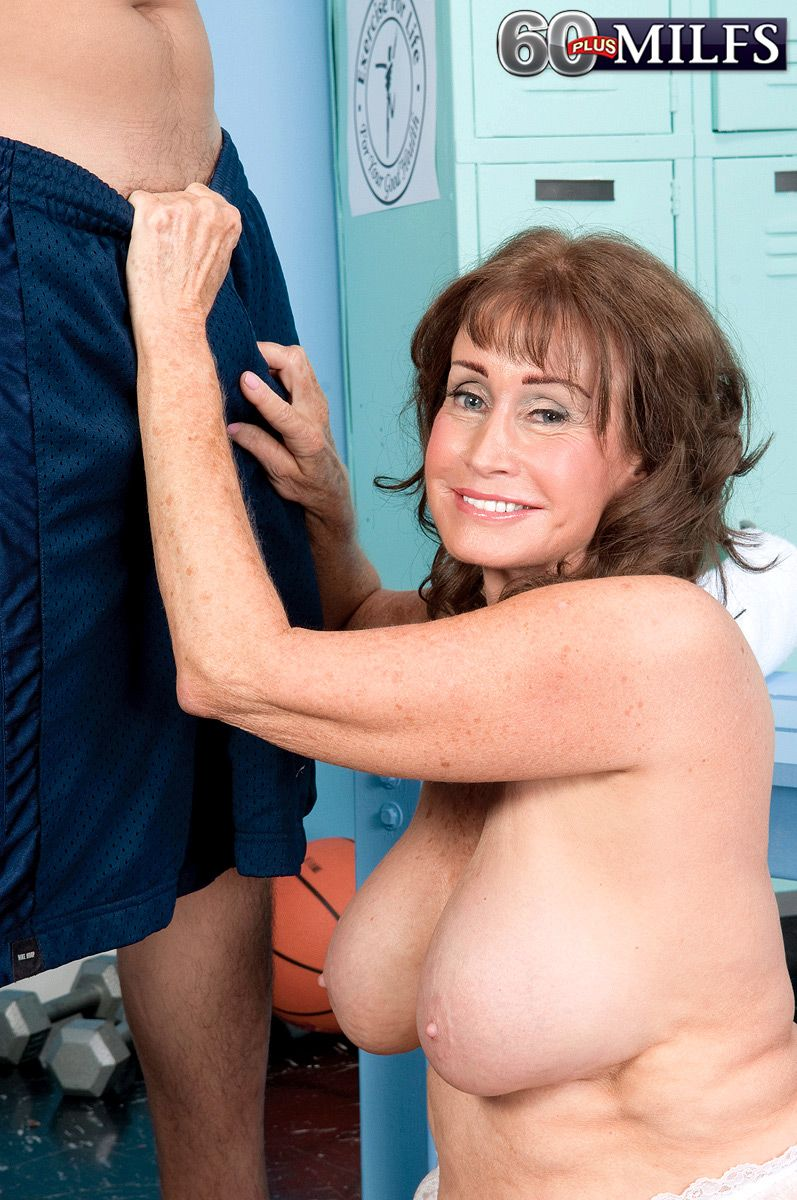Hot granny has her big bits exposed in a locker room before sucking a boy's dick