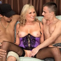 Hot over 60 blonde shows her nice tits to a couple of boys in sexy lingerie