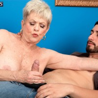 Short haired over 60 lady seduces a much younger man and the tugs on his cock