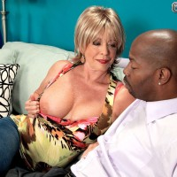 Sexy over 60 blonde bares her nice tits while put the moves on a black man