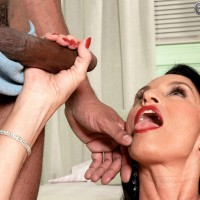 Hot mature woman sports a butt plug in her asshole during interracial MMF action