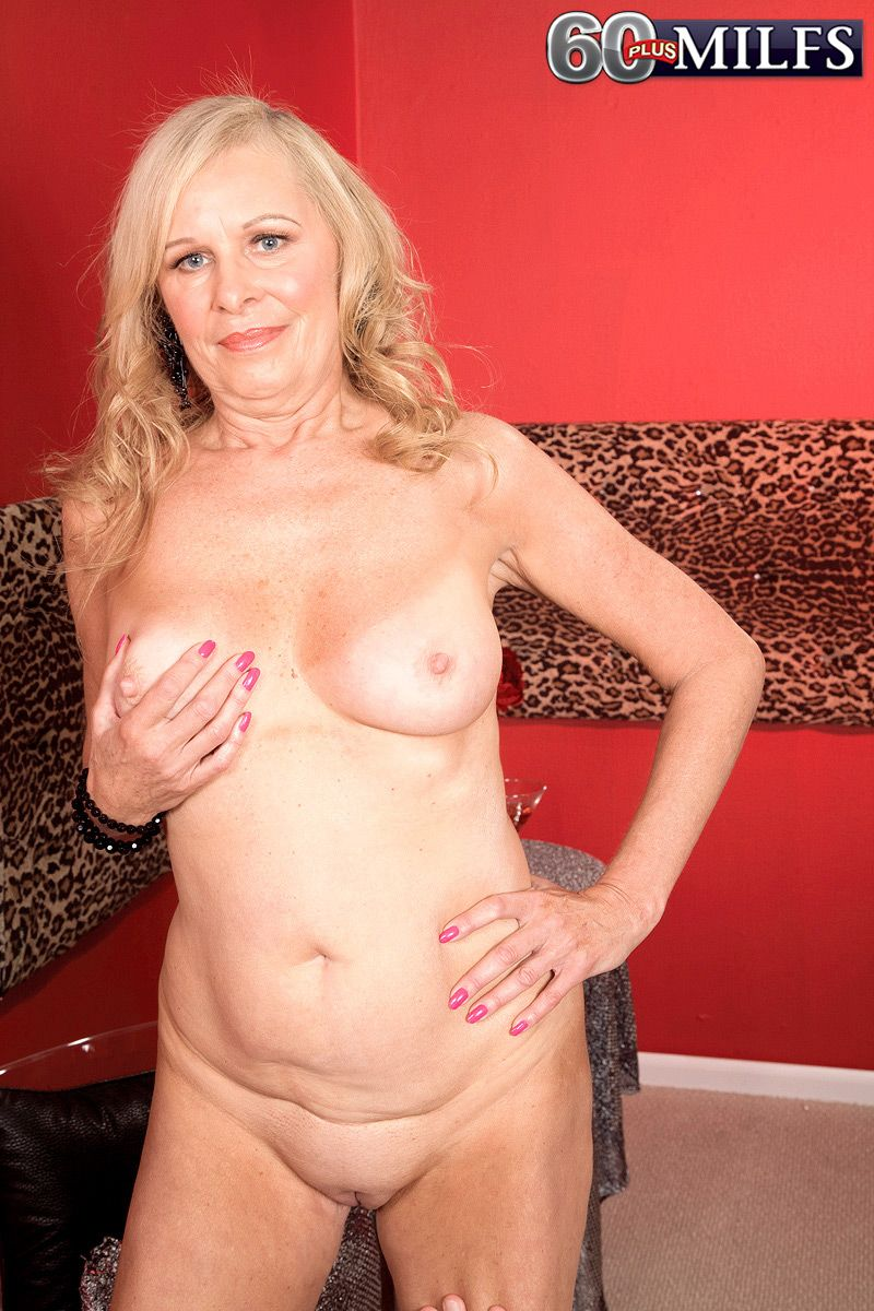 Mature blonde plays with her big natural tits while teasing a guy