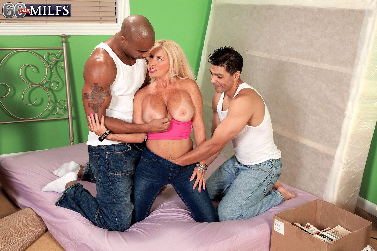 Hot over 60 nude model and pornstar has her great tits exposed by 2 younger guys