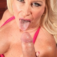 Mature blonde pornstar in stockings and garters giving big cock oral sex