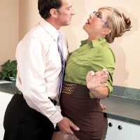 Sexy older secretary blows a coworker at work wearing glasses and pantyhose