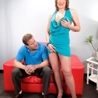 Sexy granny seduces a younger man in a short dress paired with pantyhose