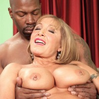Hot over 60 pornstar jerks two big black dicks at the same time in black stockings