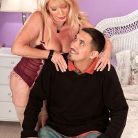 Hot over 60 MILF with blonde hair seduces her toy boy in sexy lingerie and nylons