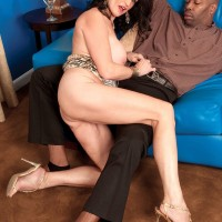 Over 60 babe has her great tits exposed and played with by a younger black man