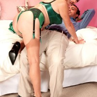 Sexy granny seduces her younger lover in satin lingerie and tan nylons