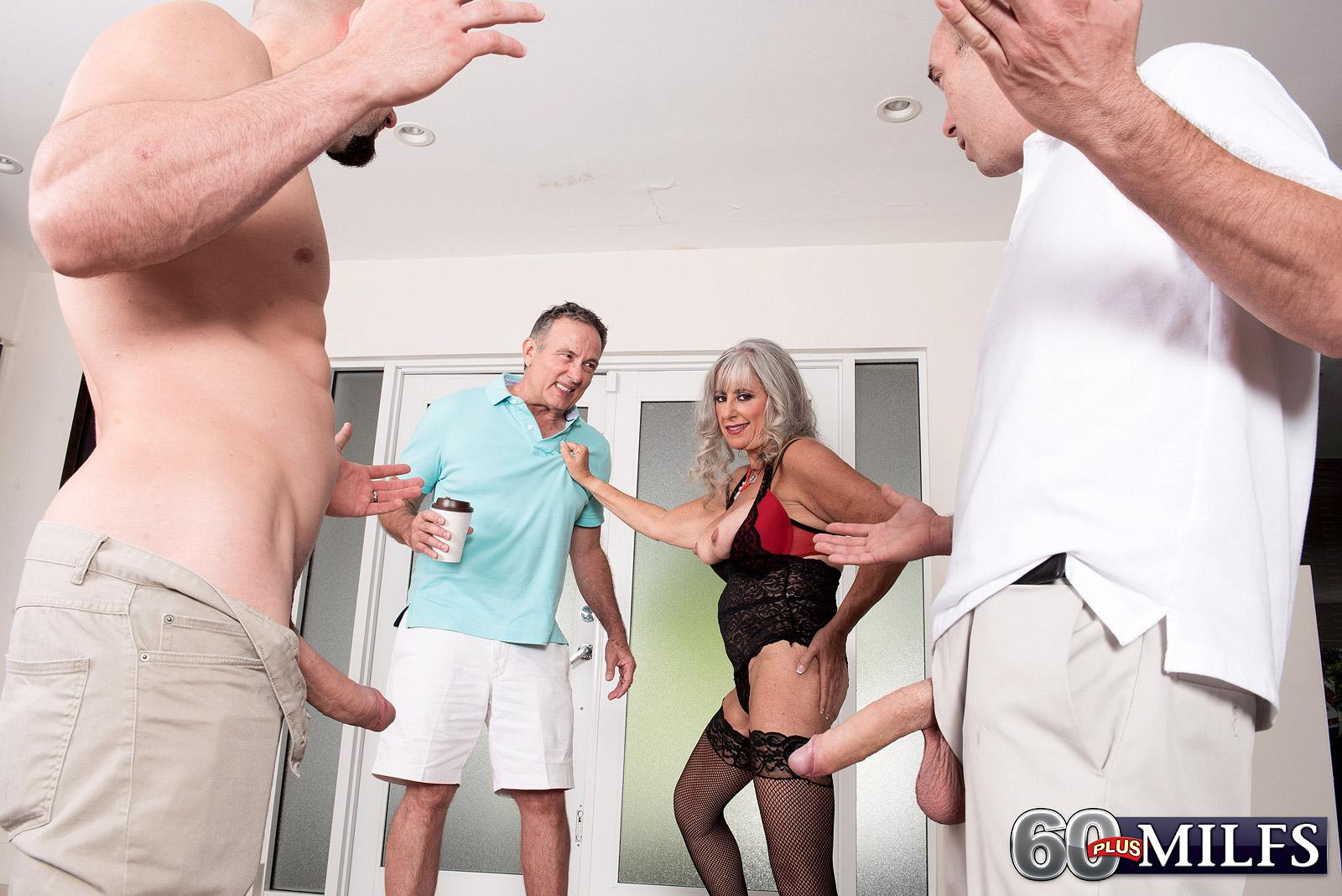 Aged woman Silva Foxx gives 2 guys oral jobs in front of her cuckold husband