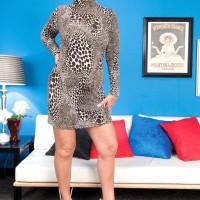 Ash-blonde grannie Jeannie Lou delivering enormous ebony wood multiracial blowjob in lingerie