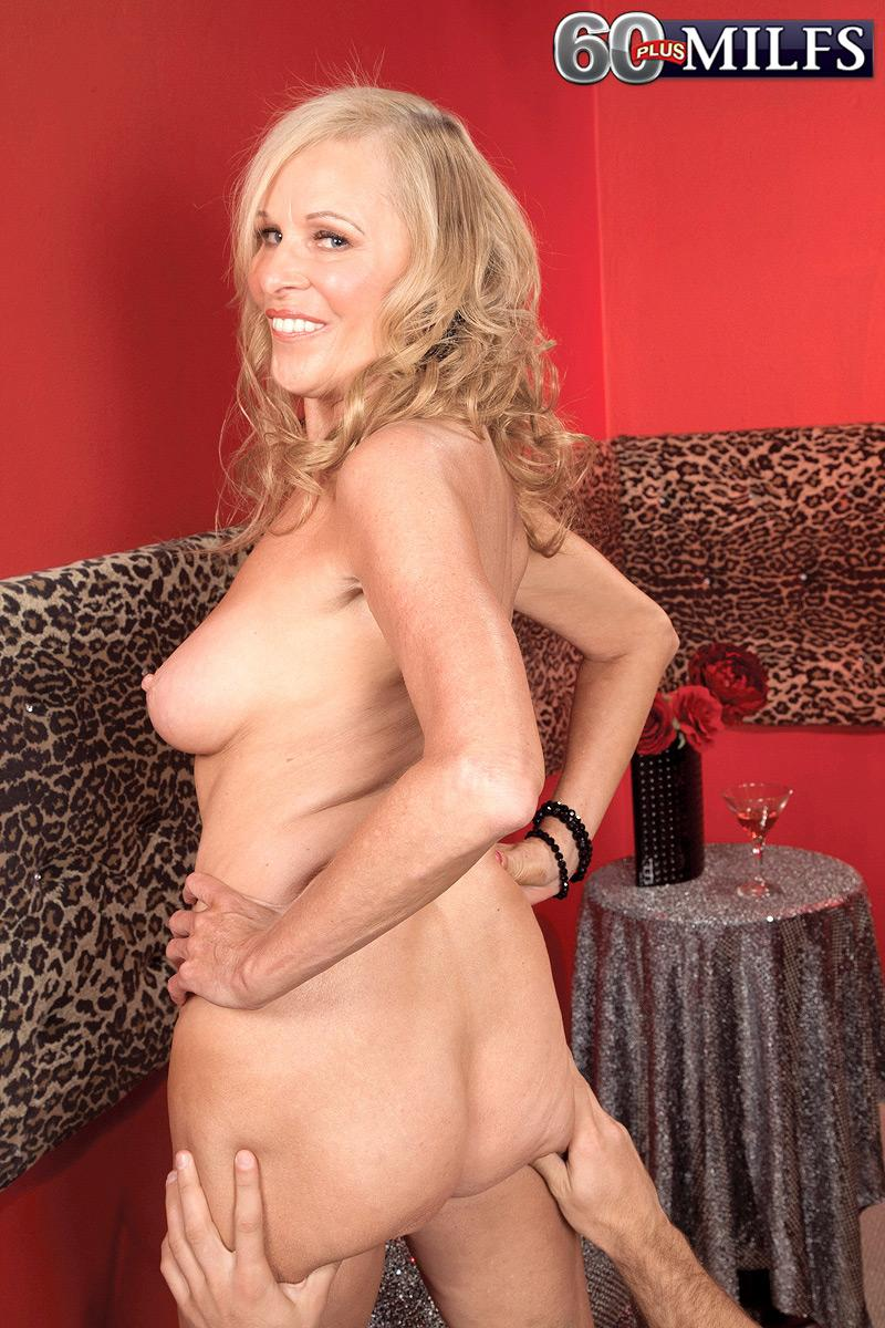 Big-boobed yellow-haired mature woman Bethany James showing off humungous boobs and upskirt panties