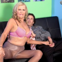 Big-chested blond MILF over 60 Bethany James delivering big penis blow job in work place