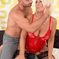 Big-titted blond granny in hose and lingerie delivering huge junk tit-screwing and blowjobs