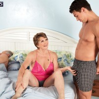 Big-titted ginger-haired grannie Bea Cummins tugging off monster-sized rod while cuckold husband sleeps