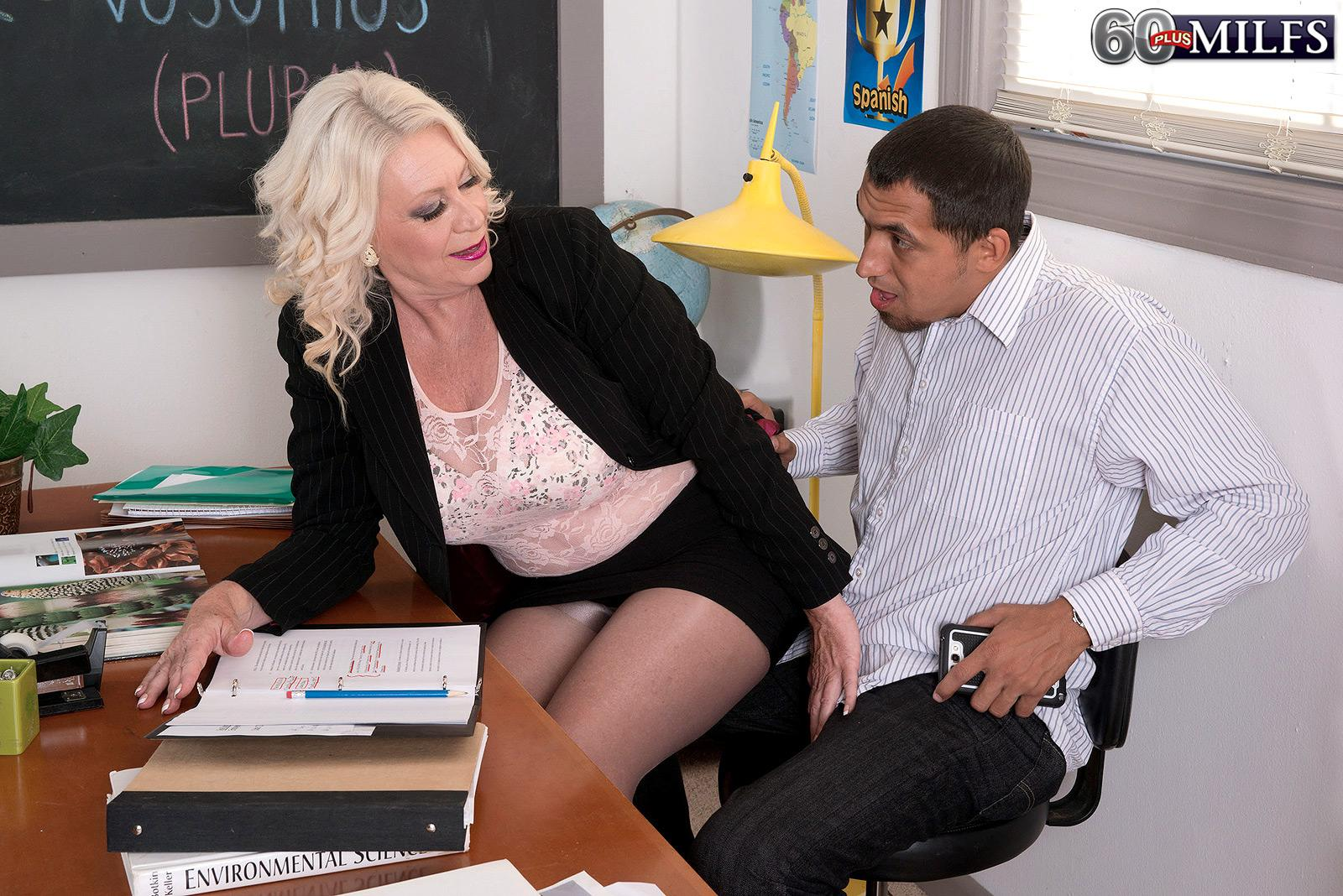 Big-titted golden-haired 60 plus MILF instructor Angelique DuBois tugging large dick in classroom