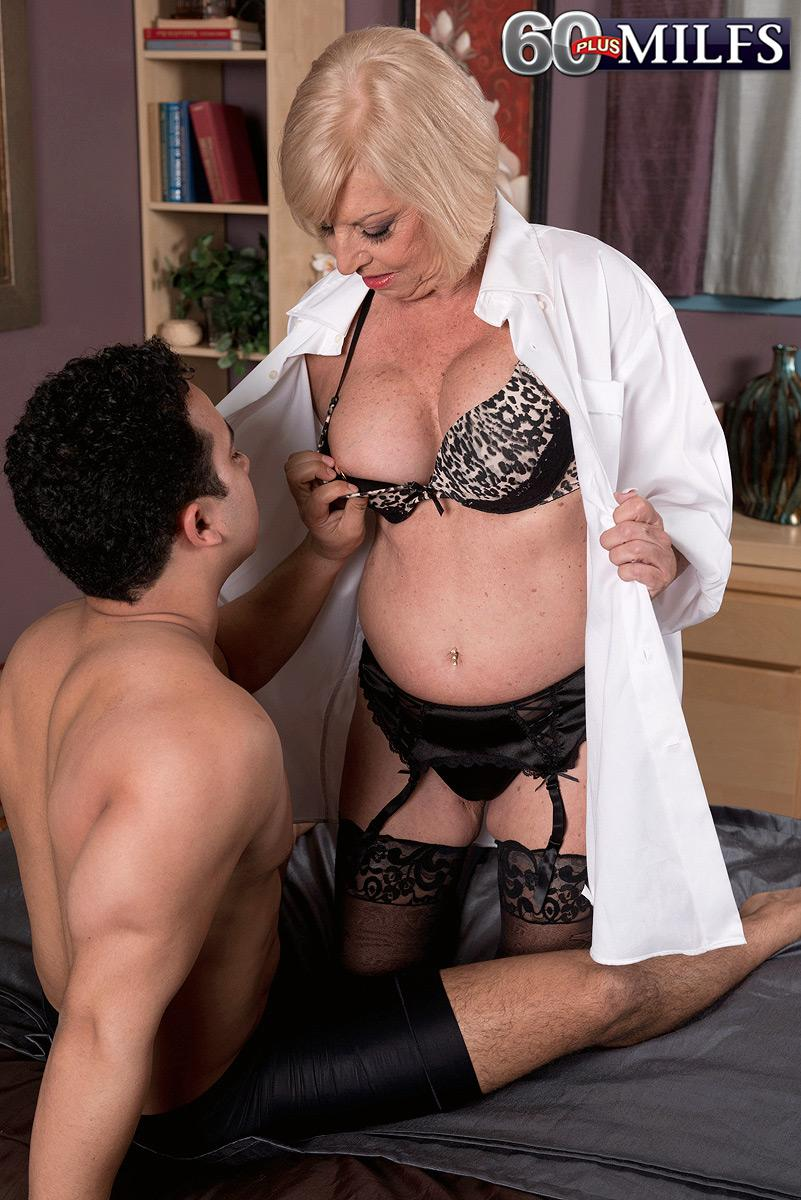 Bosomy blonde sixty plus MILF Scarlet Andrews having nipples fellated and teased