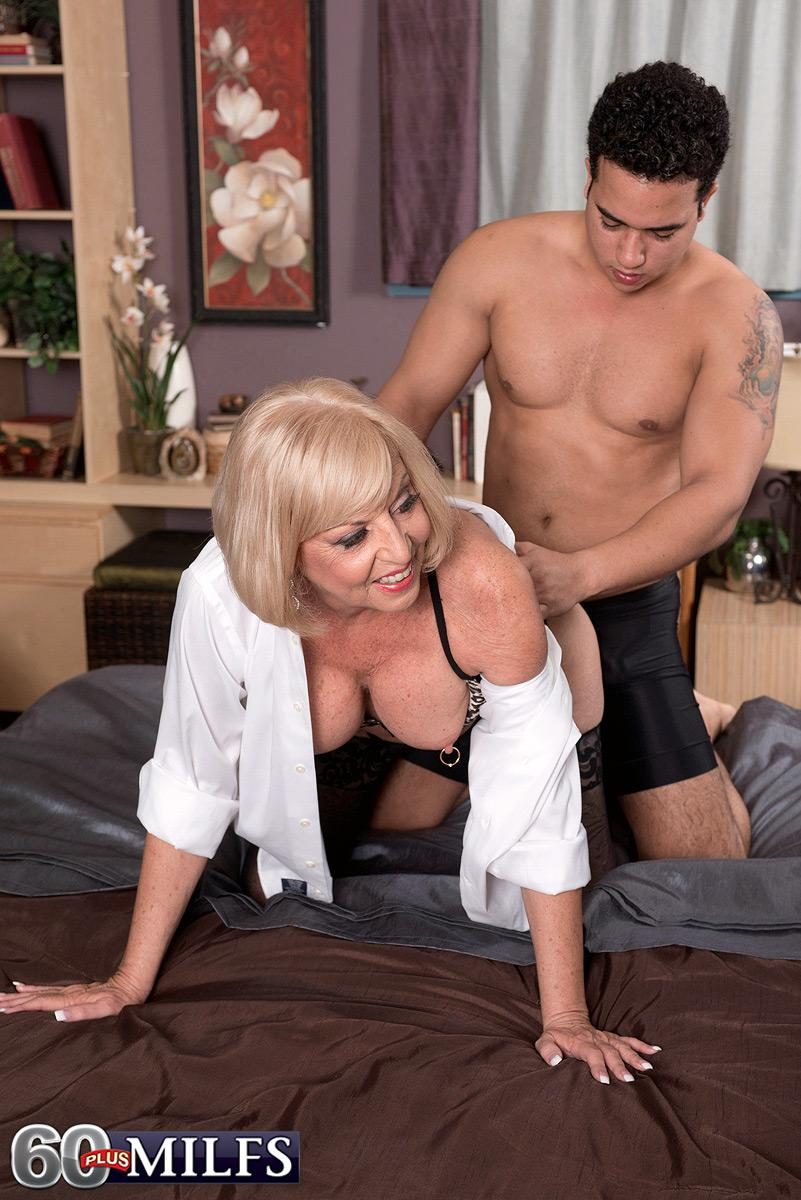 Bosomy blonde sixty plus MILF Scarlet Andrews having nipples fellated and teased