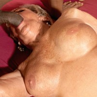 Bosomy stocking and lingerie attired 70 plus grannie Sandra Ann giving huge ebony junk a blow-job