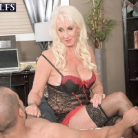Buxom lingerie wearing aged X-rated starlet Madison Milstar milking wood in nylons
