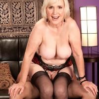 Buxom older XXX pornstar Lola Lee delivering oral pleasure in hose and lingerie