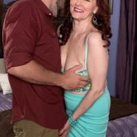 Chesty ginger-haired MILF over 60 Katherine Merlot giving gigantic dick tit-banging in nylons